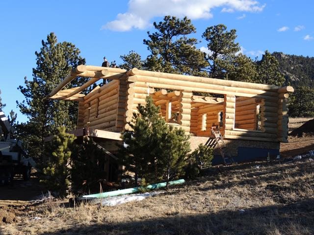 Cabins in construction rustic ozark log cabins for Rustic cabin kits